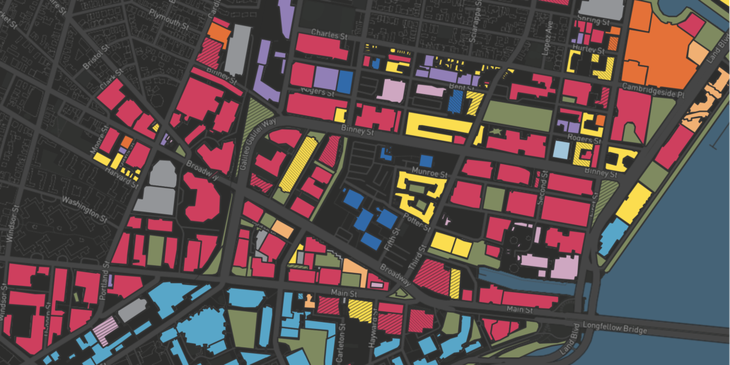 A 2018 map of MIT's Kendall Square depicting the concentration of commercial R&D/office buildings (pink) surrounding MIT university buildings (blue).